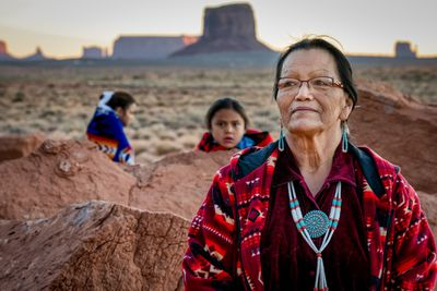 A Grandmother, Grandson and Granddaughter in Monument Valley Tribal Park, Arizona.