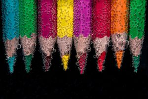 Colored pencils lined up next to each other.
