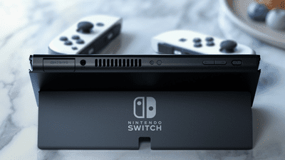 Nintendo Switch OLED with new kickstand and white controllers on a marble table