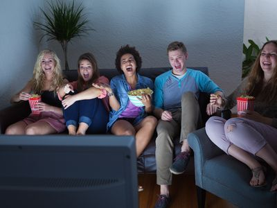 A group of friends watching TV.