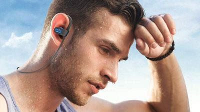 Man with earbuds working out