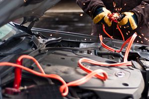 car battery jumper cables being sparked together