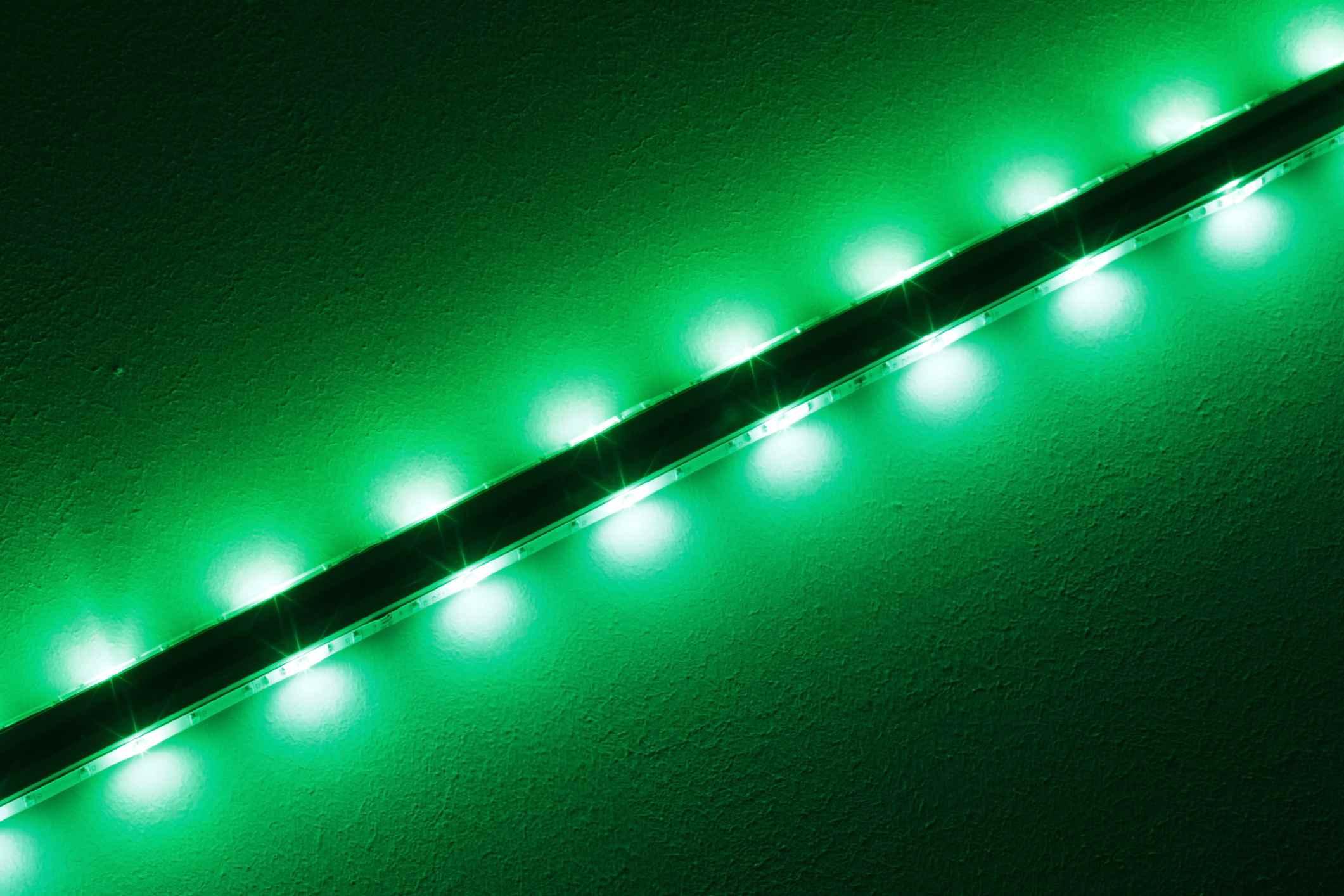 Closeup of green-glowing LED light strip