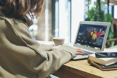 A woman cancels Paramount+ on a laptop.