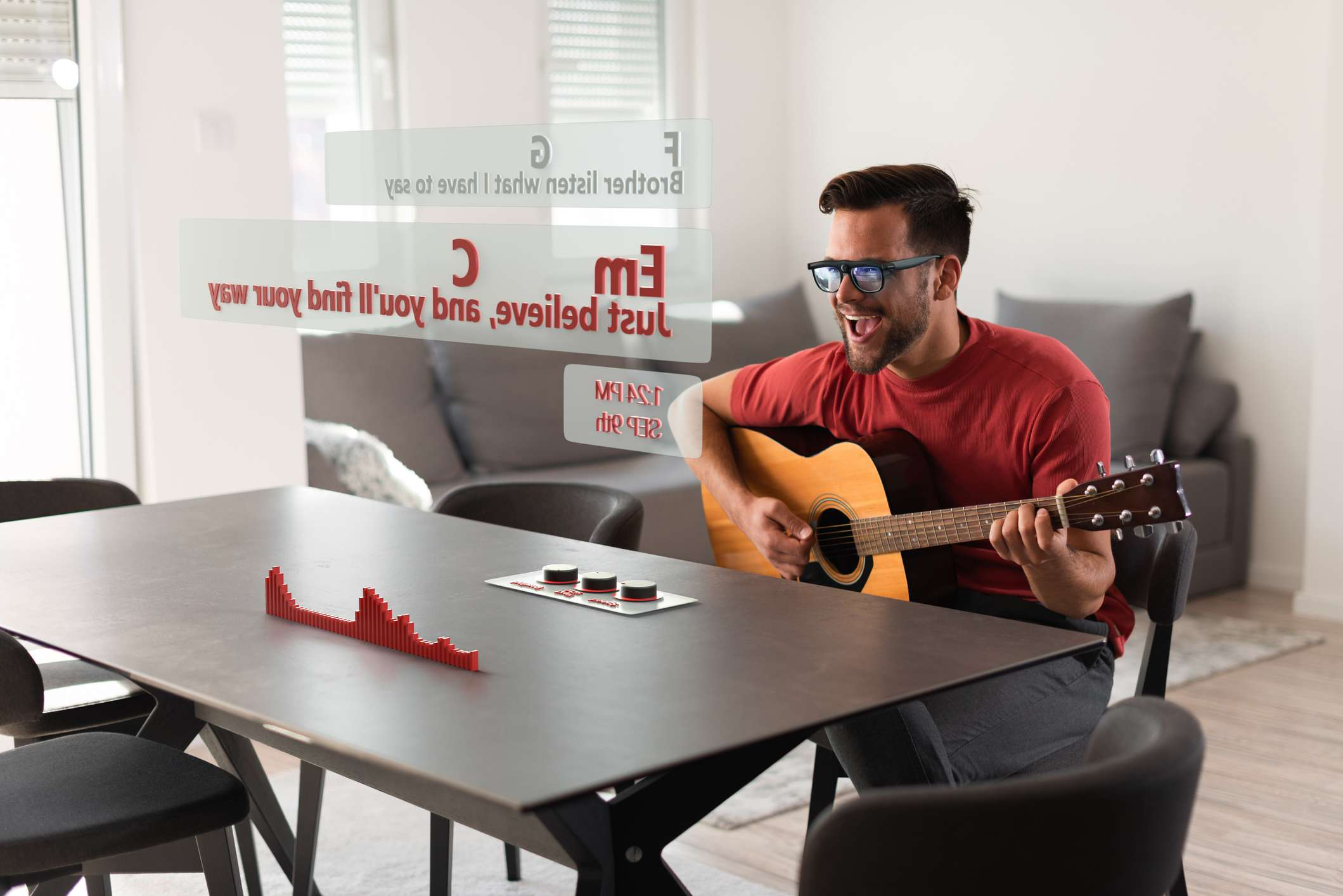 Man is using Augmented Reality glasses to see the lyrics and chord of the song he is playing on the guitar.