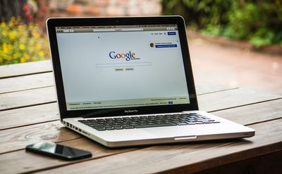 An image of Google opened in a web browser on a laptop.
