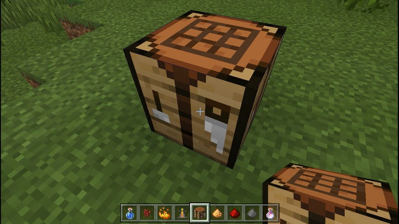 Place the Crafting Table on the ground and interact with it to open the 3X3 crafting grid.