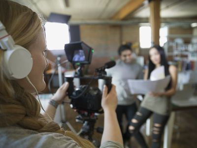Business people filming tutorial