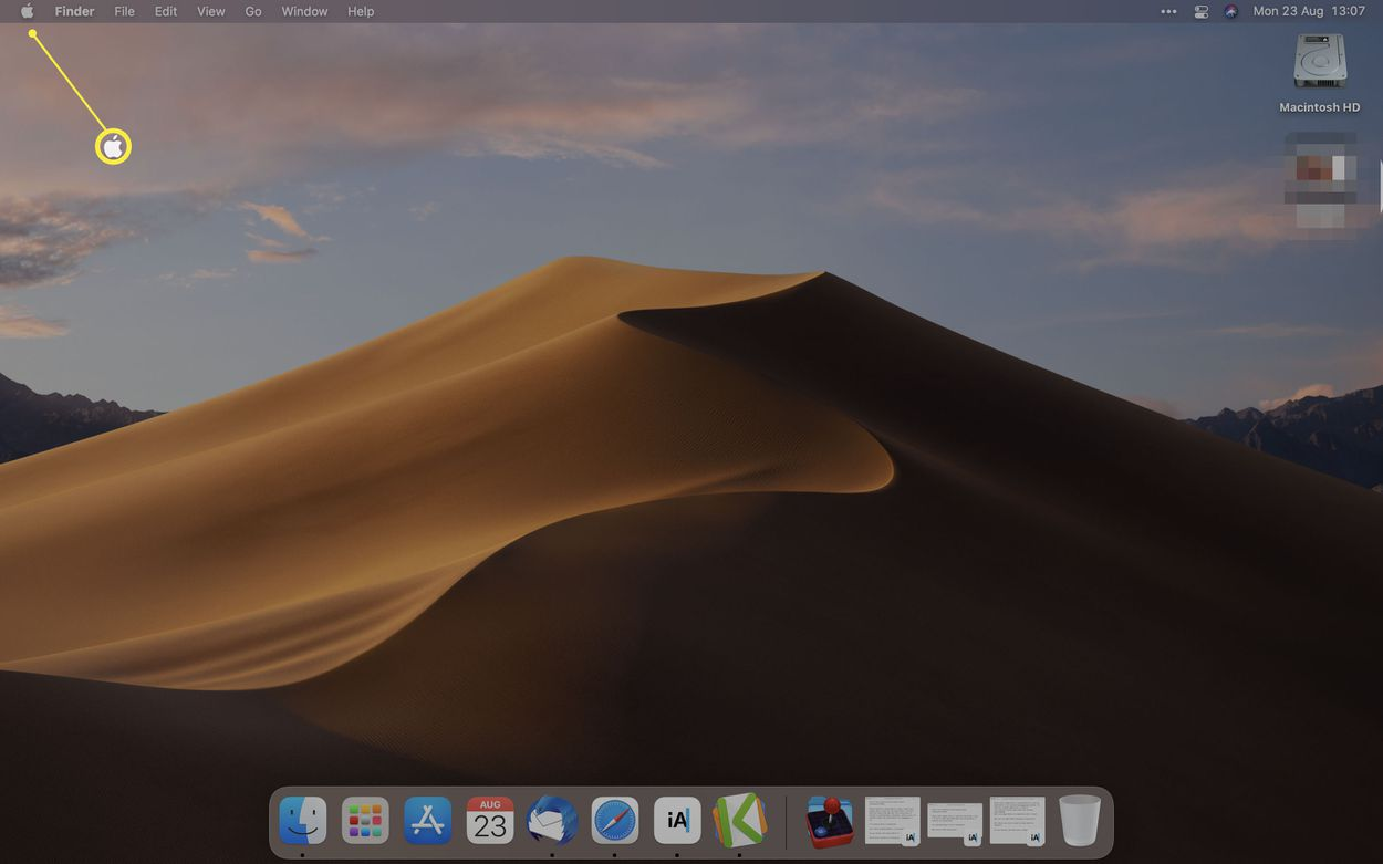 The macOS desktop with the Apple logo highlighted