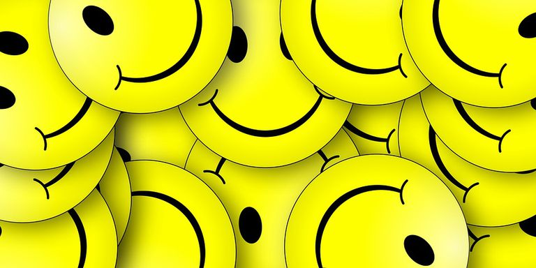 Illustration of lots of yellow smiley faces on top of one another