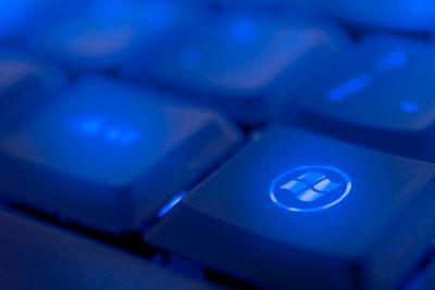 Windows key illuminated by blue LED light.