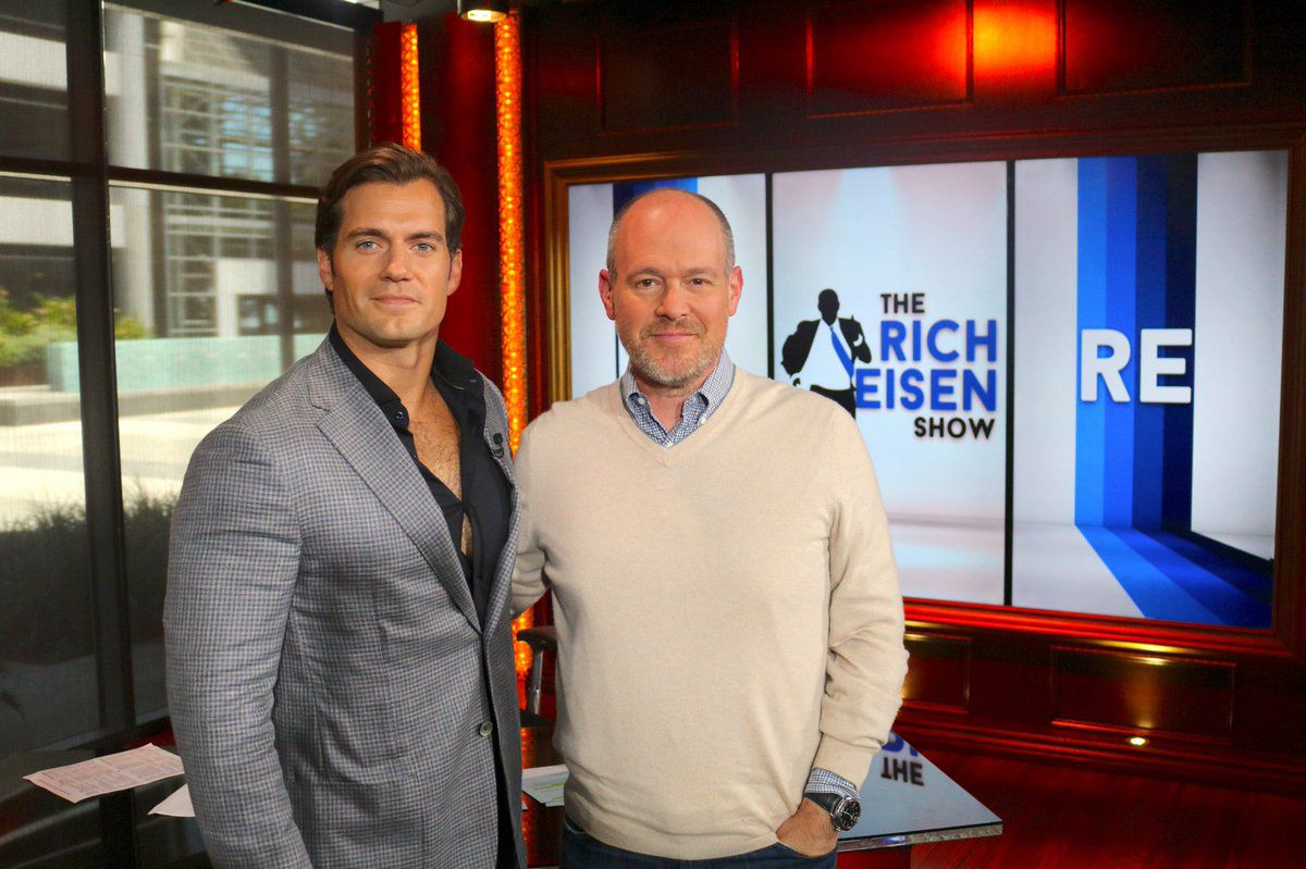 Rich Eisen poses with actor Henry Cavill on The Rich Eisen Show