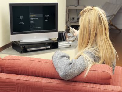 A woman connects her Fire TV to Wi-Fi.