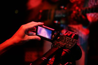 Adjusting the camera viewfinder while shooting a live performance