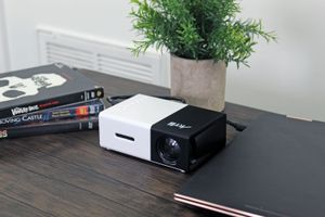 A projector connected to a laptop.