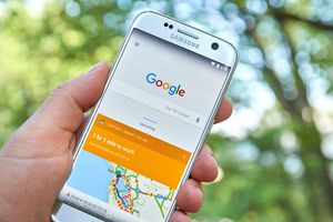 man holding samsung phone with google maps