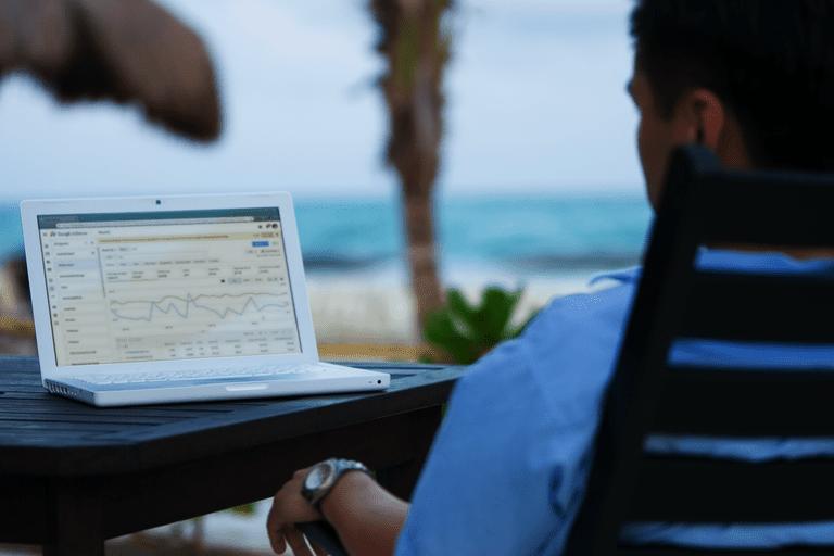 A man checks his AdSense on a laptop.