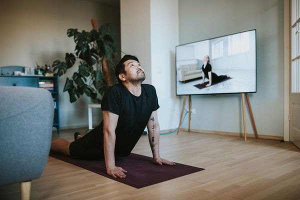 Someone streaming yoga on a large TV screen.