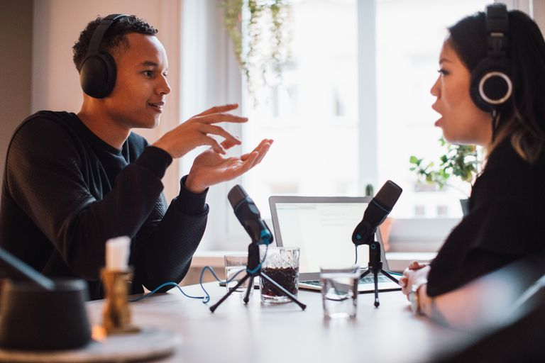 Man and woman hosting a podcast show.