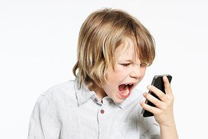 Kid screaming at cell phone