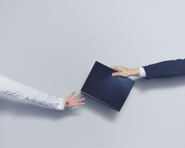 Man giving document to woman