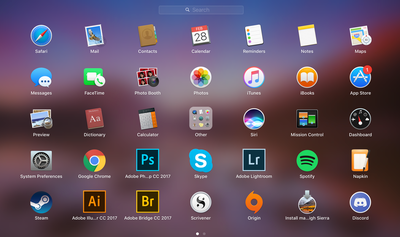 The Mac Launchpad is open with app icons displayed over a gradient background.