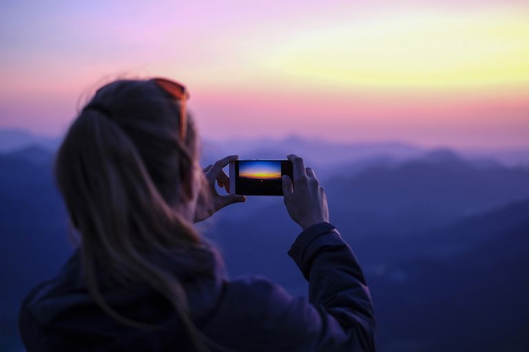 Making smartphone photos on mountain