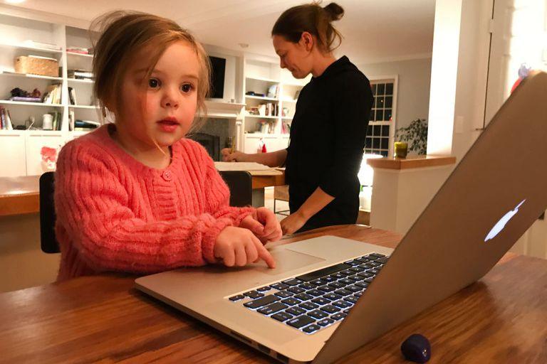 3 year old girl working on a Mac