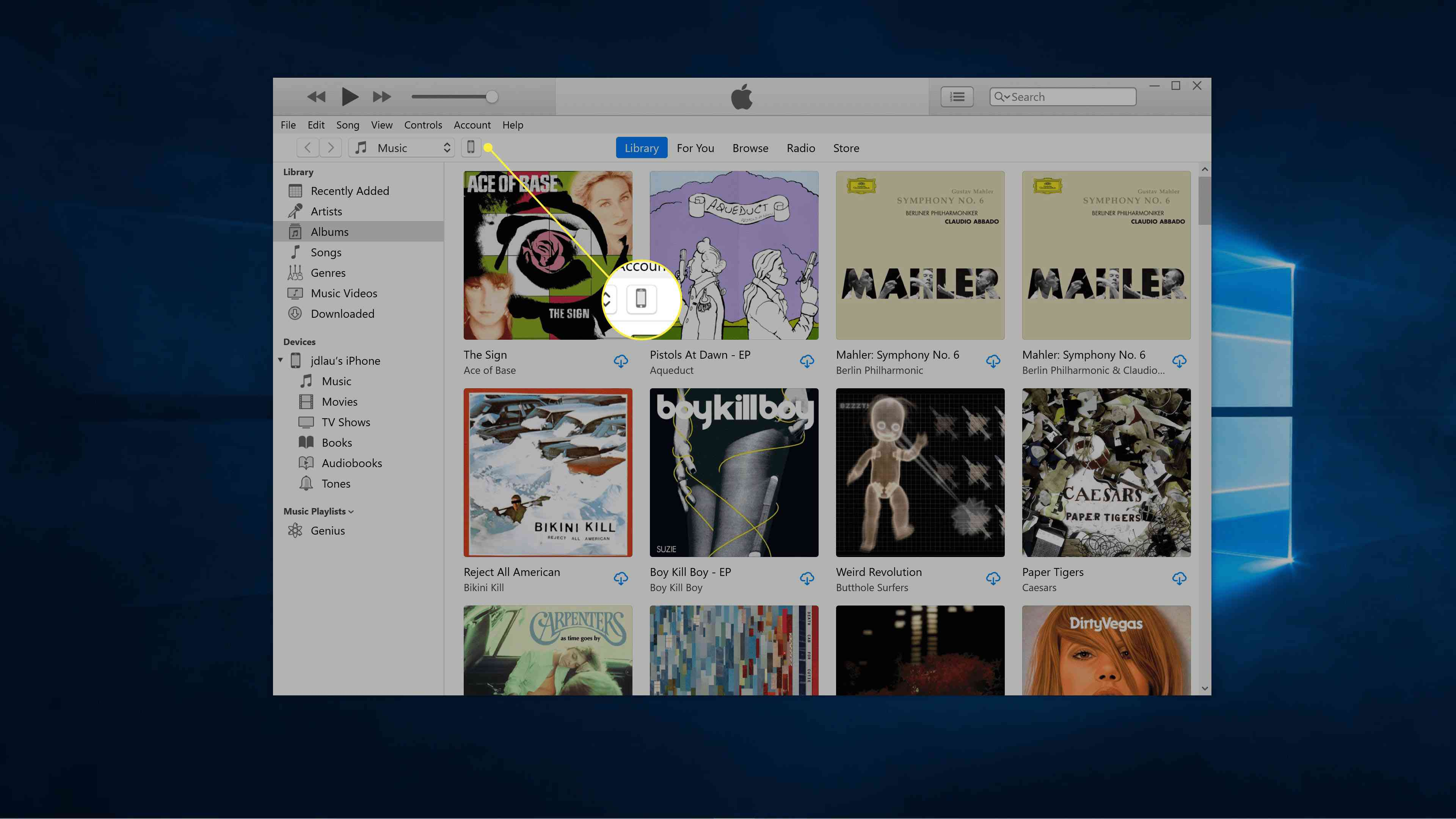 The iPhone icon to the right of Music highlighted in iTunes.
