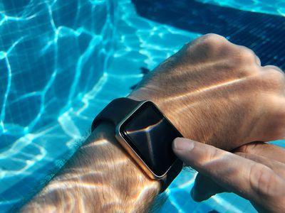 Closeup of an Apple Watch underwater.