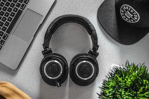Laptop, headphones and cap