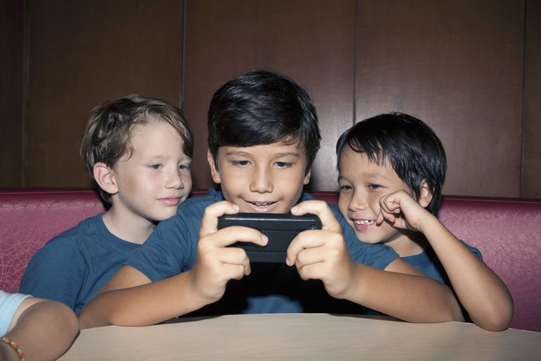 Kids playing phone game