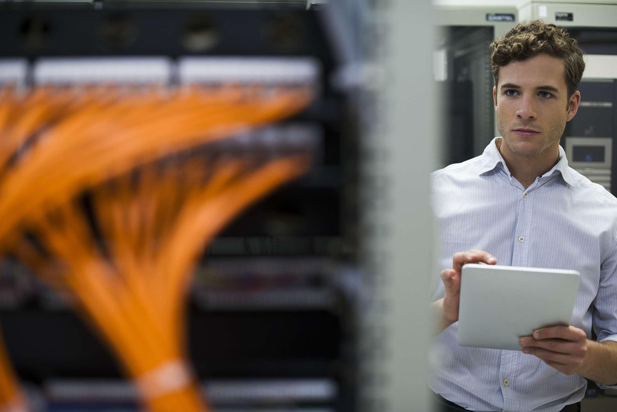 A man in a server rack