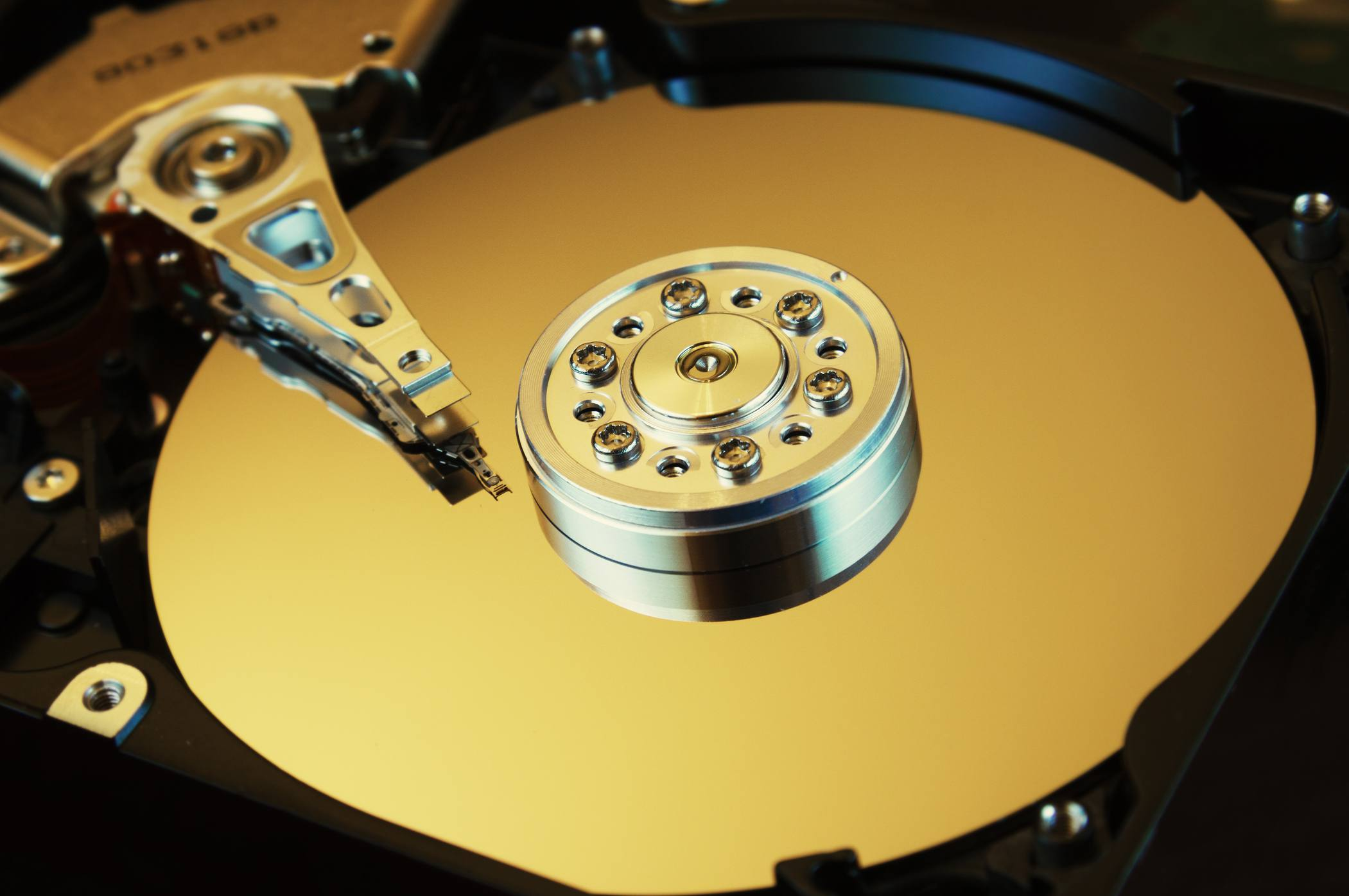 HDD Open with platters and actuator exposed.