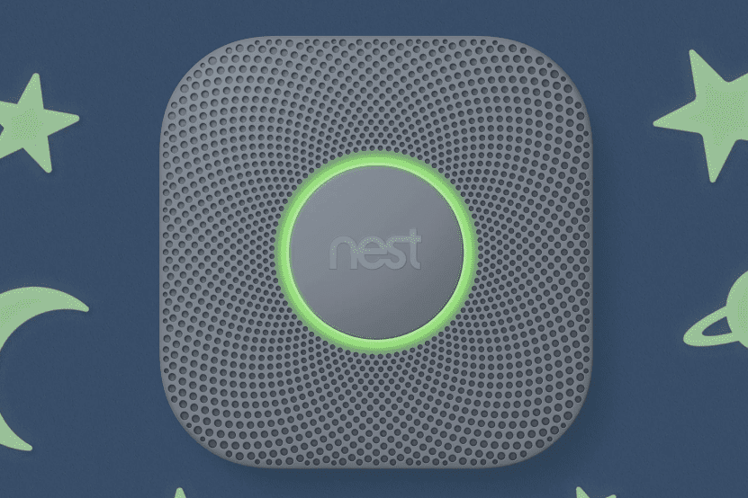 Nest Protect with a green glow on a background with stars