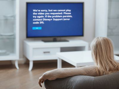A woman looks at Disney Plus error code 39 on her TV.