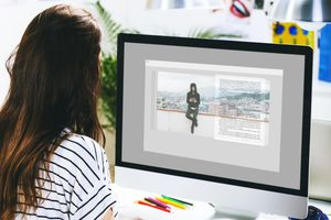Female fashion model working in her office
