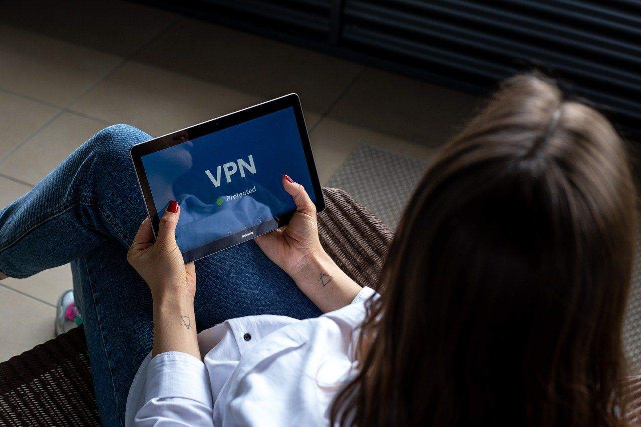 Person using a tablet with the word VPN written on it