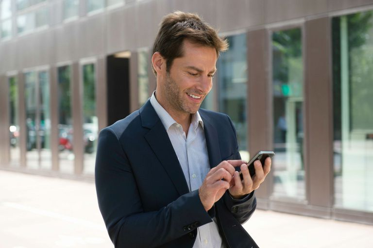 Man using Mobile Messaging on cell phone