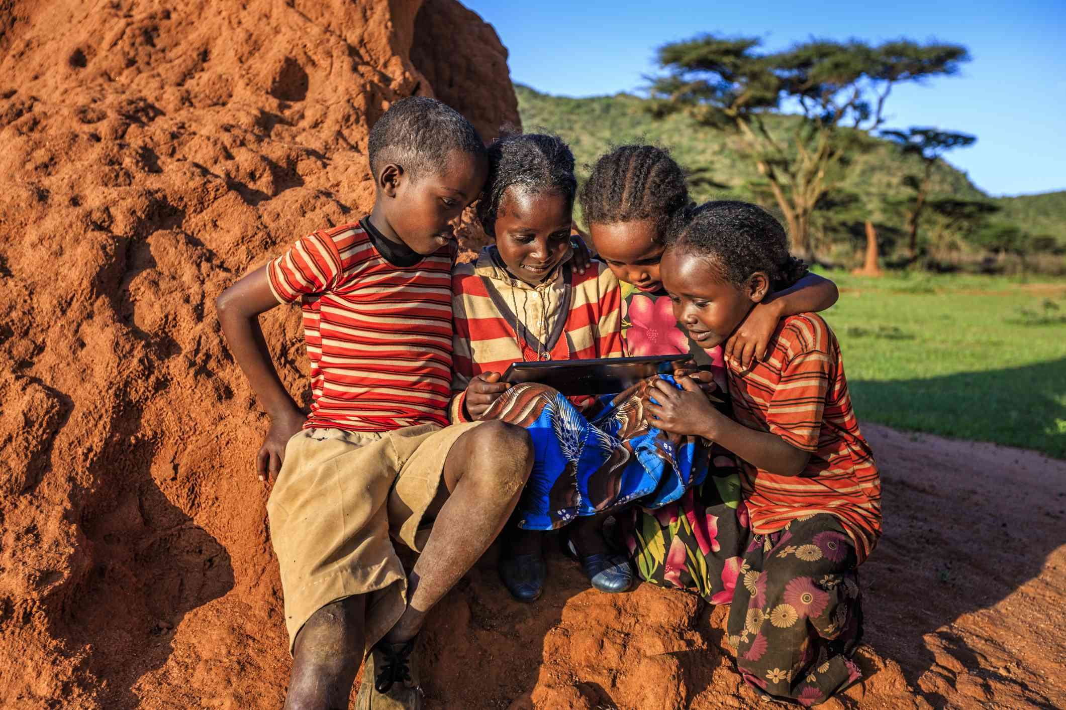 Children in East Africa using a tablet computer.