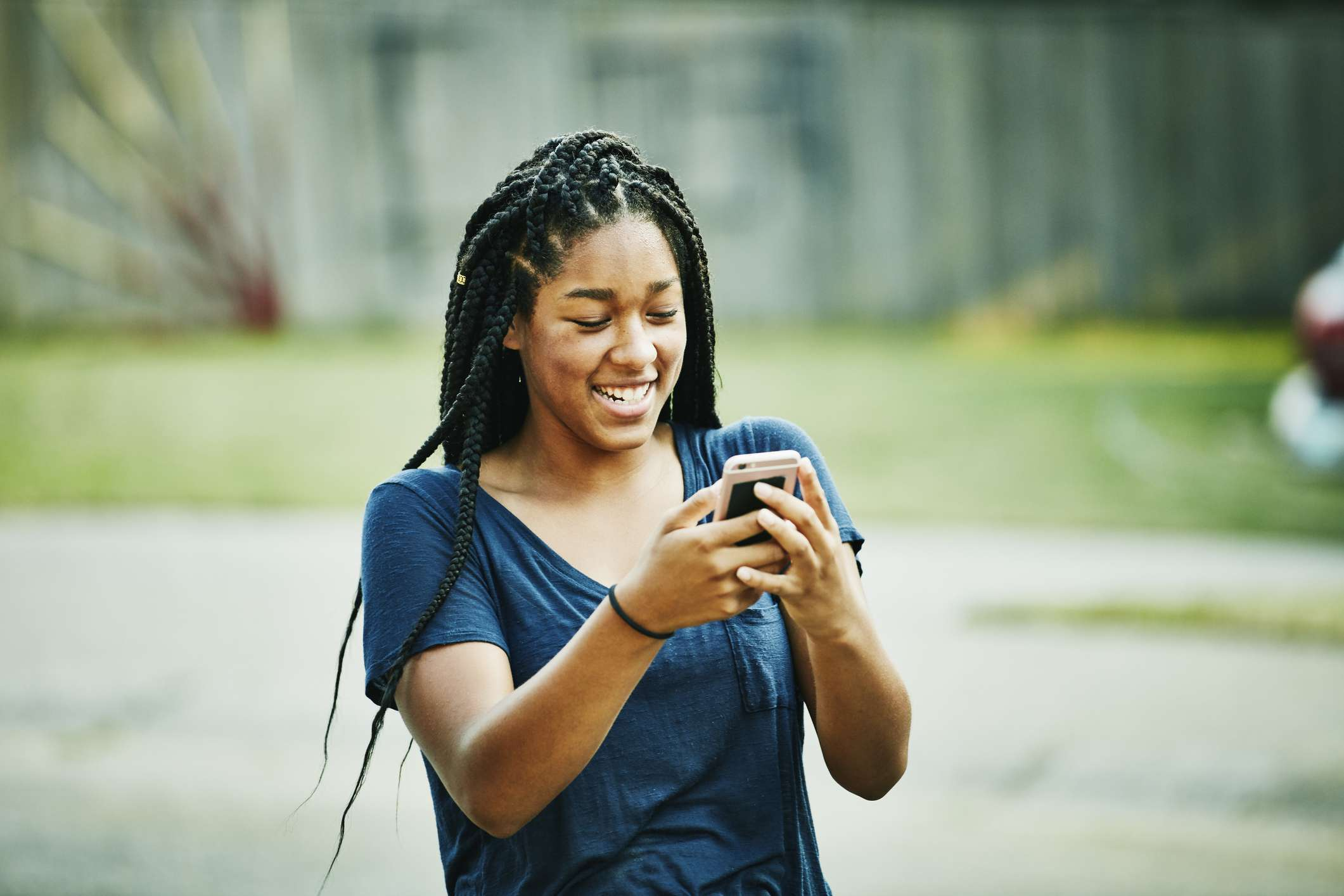Teenager laughing smartphone