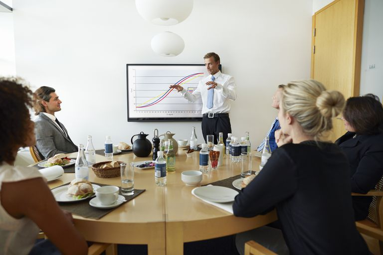 man giving presentation to office