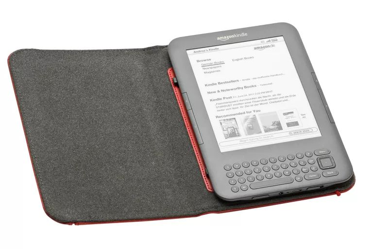 A Kindle 3 with the cover opened