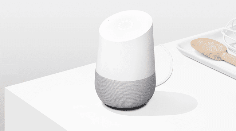 A Google Home device sitting on a table