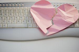 Close up of broken heart on computer keyboard