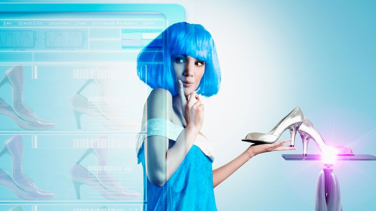 A futuristic woman with blue hair trying on smart clothes, in this case shoes.