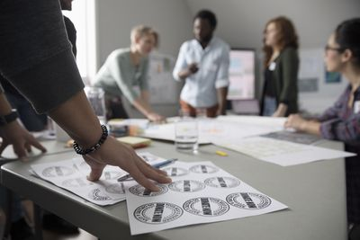 Graphic designer displaying a logo design