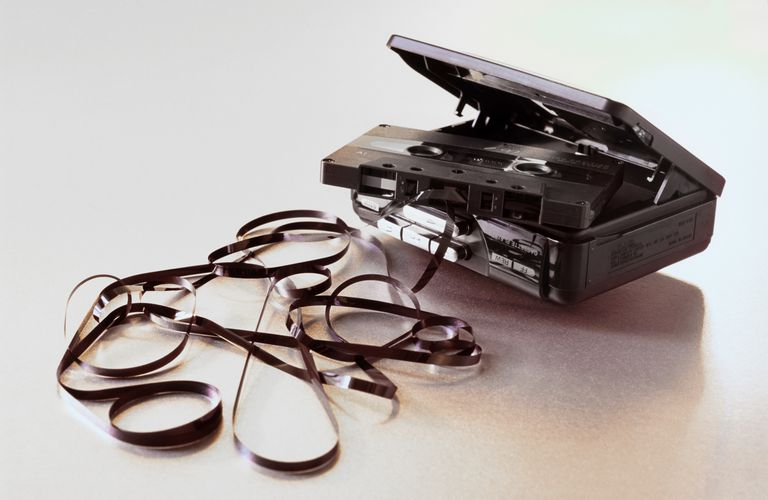 Close-Up Of Audio Cassette And Player Against White Background