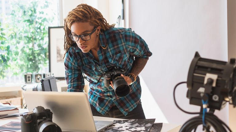 A female photographer emailing photos on her Windows 10 laptop.