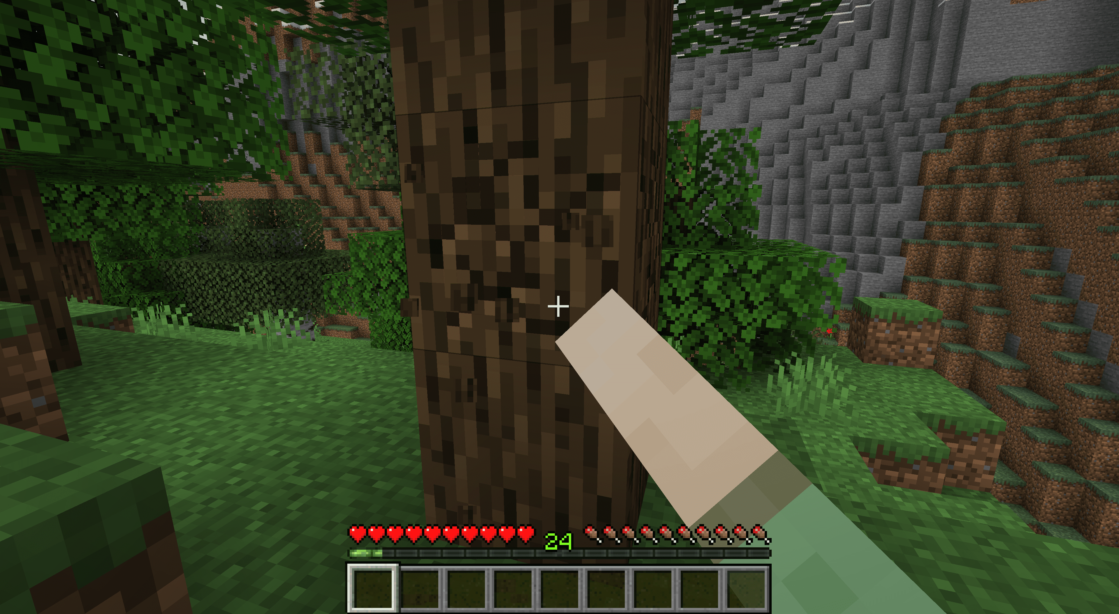 Punching a tree in Minecraft.